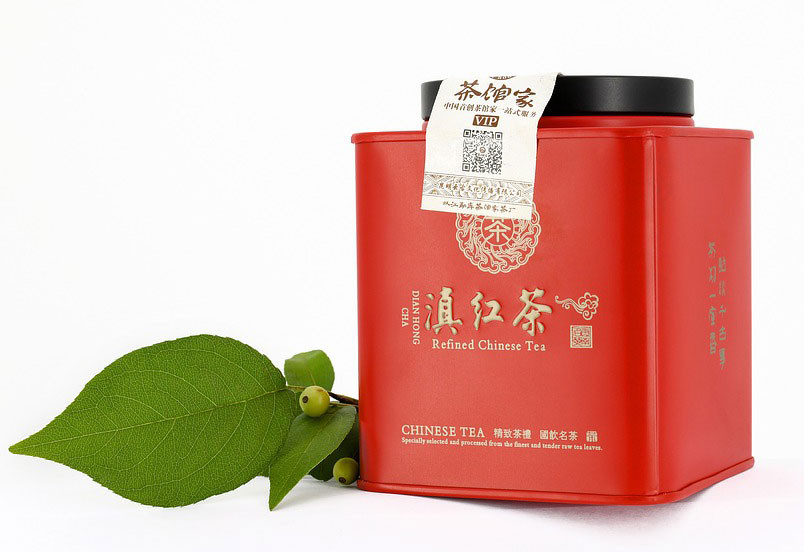 a red metallic tea caddy with a sleek design