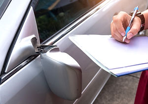 insurance-officer-checking-car-accident-