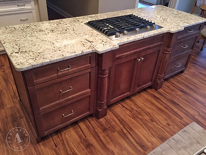Stained custom island cabinets with pull out legs