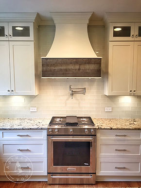 white shaker cabinets to the ceiling with glass double uppers