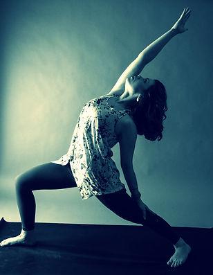 Ayesha taking yoga asana reverse warrior