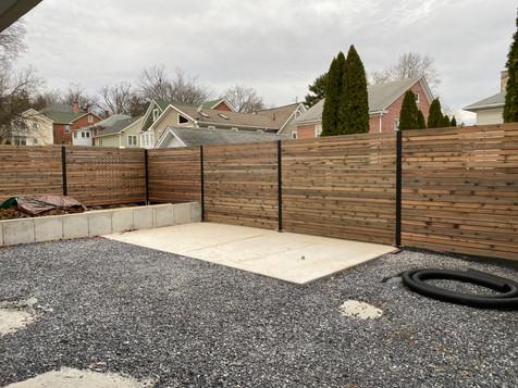 Cedar and steel fence