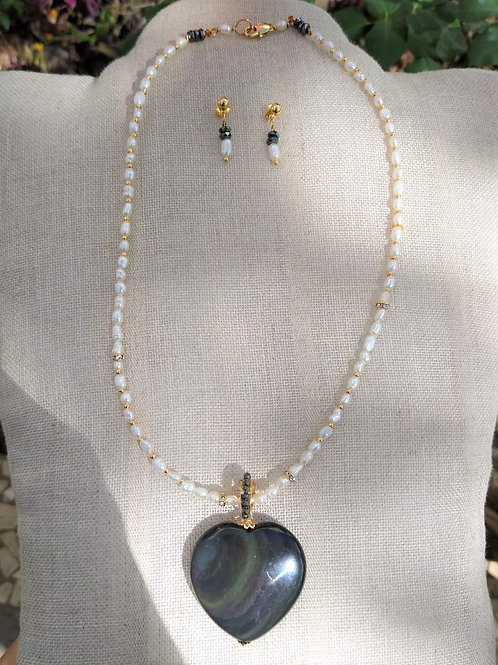 Obsidian rainbows and cultivated pearls. Sustainable Jewelry