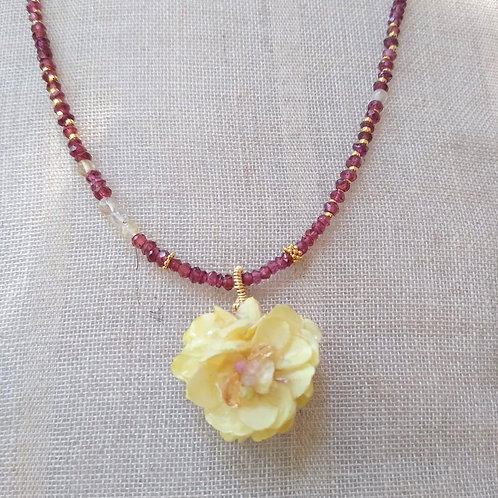 Flower with bio-resin and garnet.