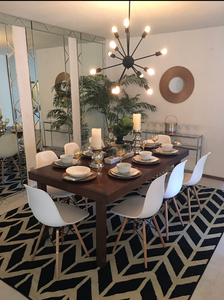 Modern Dining room with Sputnik Light and Black and White rug