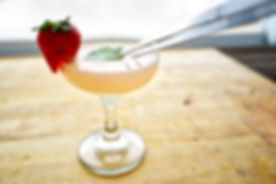 Strawberry Shrub Daiquari featuring white rum, lime juice, and sugar. Delicious drink that you can make from the comfort of your home.