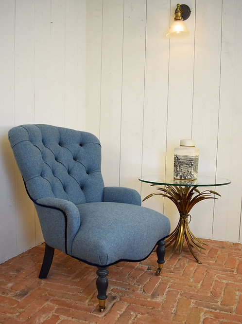 A beautifully reupholstered 1980's tub chair