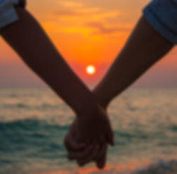 Couple Holding Hands at Sea Sunset.jpg