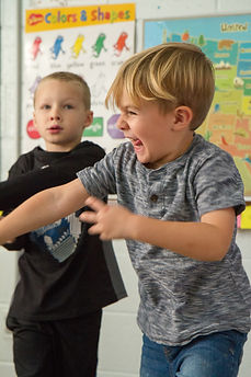 Kids acting in drama class
