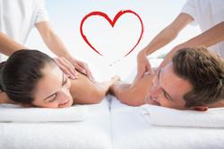 Peaceful couple enjoying couples massage poolside against heart