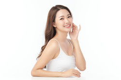 Beautiful young asian woman with clean fresh skin on white background, Face care, Facial t