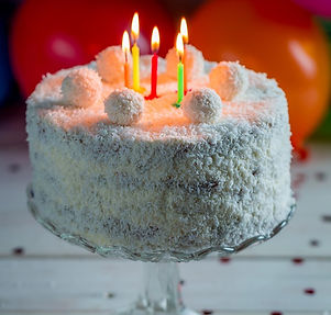 December birthday cake recipe. Coconut covered red velvet cake with cake ball truffles