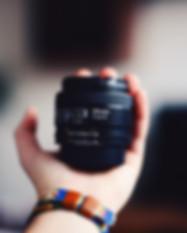 hand holding lens
