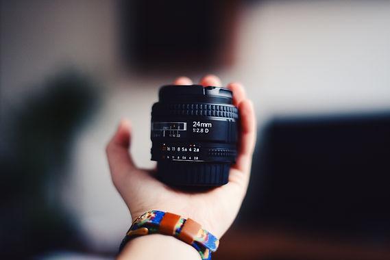 hand holding lense