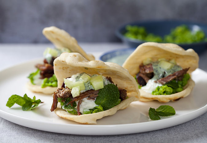 Pulled lamb with pea puree and a yogurt and mint dressing