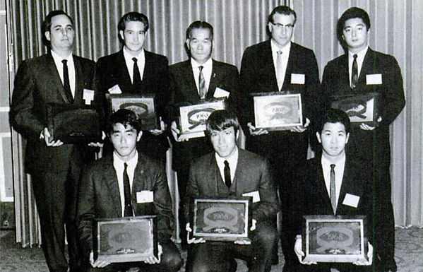 Caylor Adkins (2nd from left back row) Chuck Norris (Middle first row)