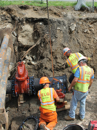 """Installing 24"""" ductile iron pipe T and 24"""" gate valves"""