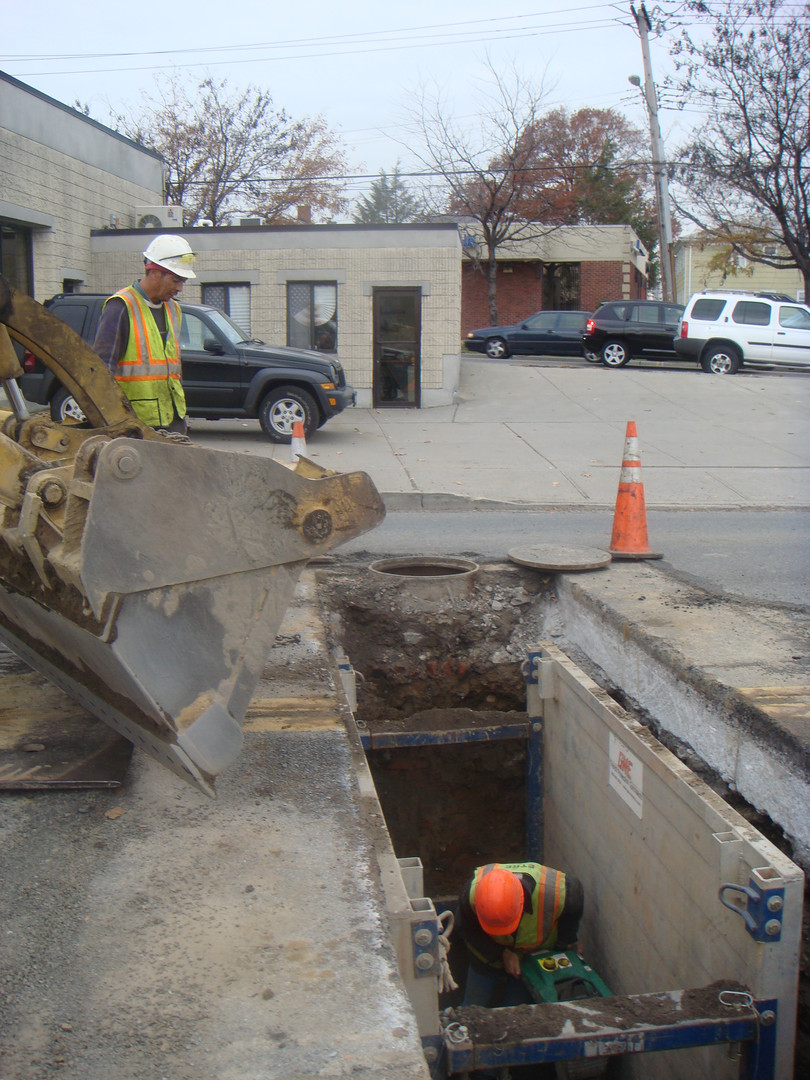 Backfilling and compaction in trenches and excavations while observing safety with the use of a trench box.