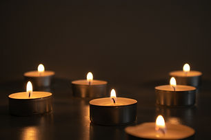 bigstock-Seven-Small-Lighted-Candles-In-