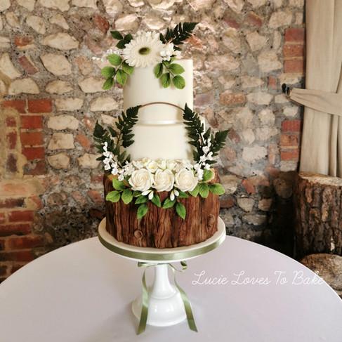 Woodland Greenery and White Floral Wedding Cake
