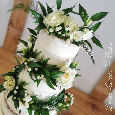 Green Foliage and White Semi Naked Vegan Wedding Cake