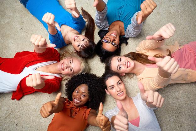 photo- circle of multiracial women lying