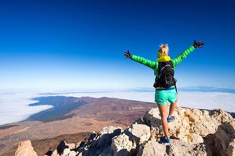 photo- hiker at mountain peak.jpg