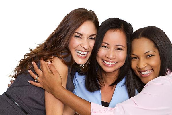 photo-three multiracial friends hugging.