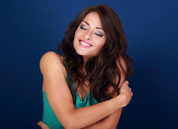 Photo happy woman hugging herself.jpg