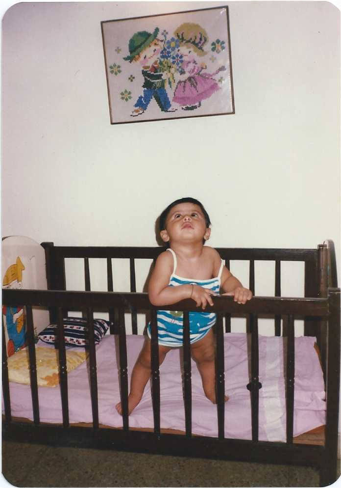 7 month old baby in cot.jpg