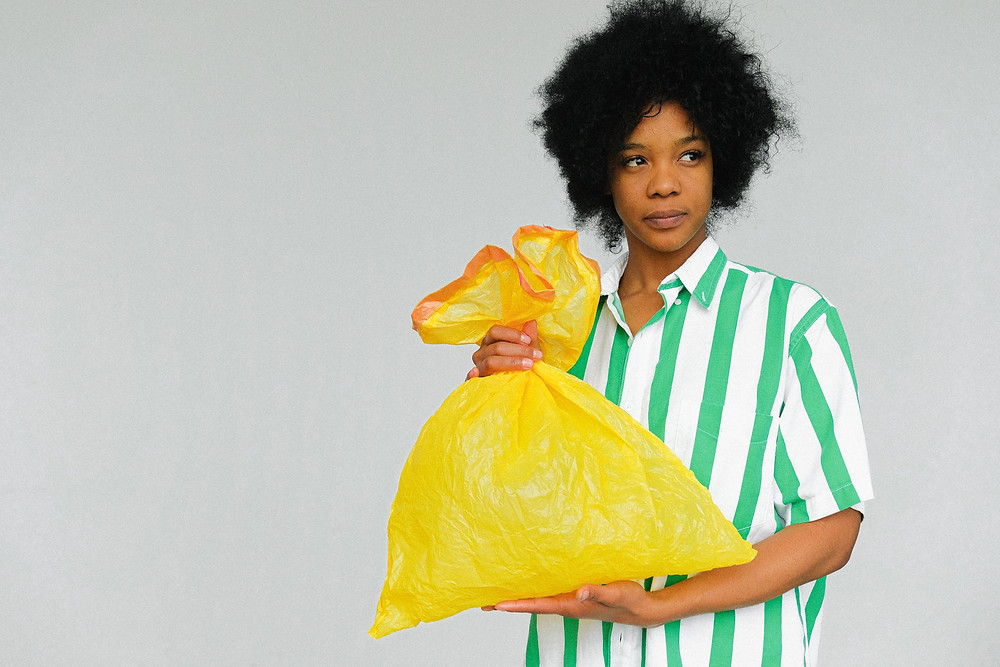 Woman with trash