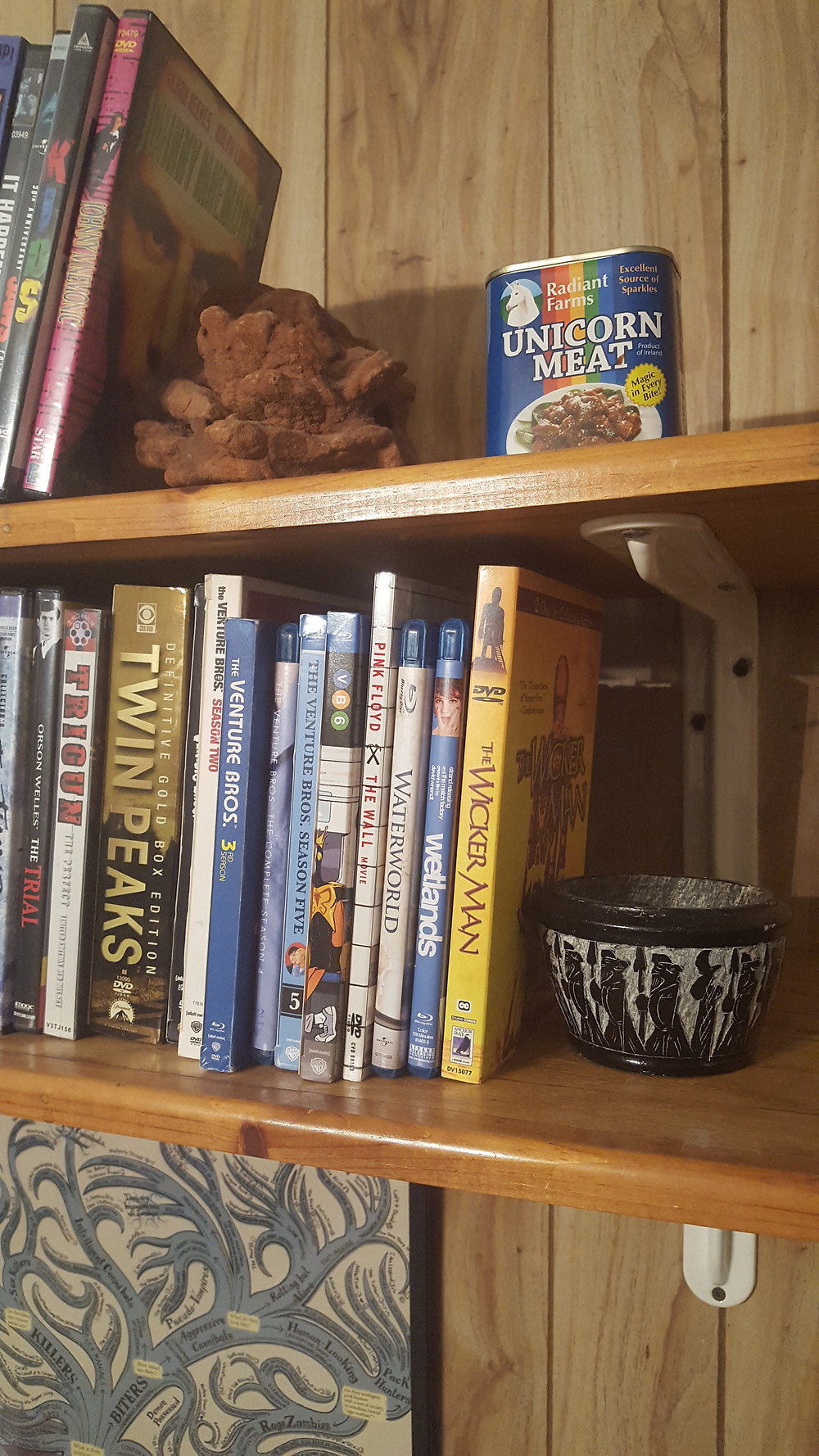 cool brown rock and sentimental mortar are bookends on the other side of this DVD shelf