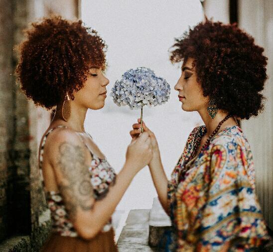 two ladies with flower.jpg