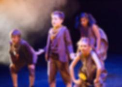 Children singing on stage