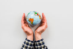 earth-globe-surrounded-by-hands.jpg