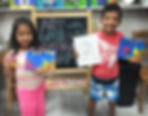 smiling kids hold up their art at Summer Art Camp