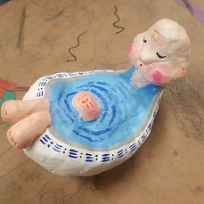 hand made sculpture of a character taking a bath