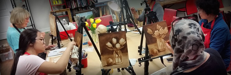 a group of people painting at Winged Canvas Art Hub