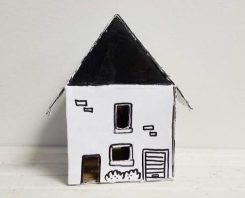 A cardboard house.