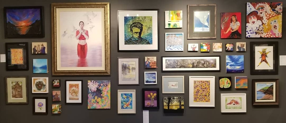 Winged Canvas Gallery Salon Show - eclectic styles of art hung together