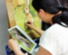 A woman draws a rabbit in Beginner Art for Adults class
