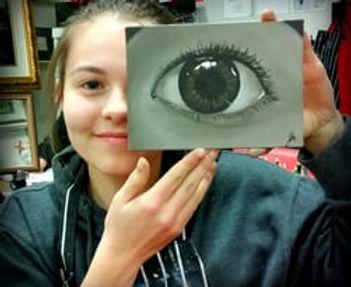 Teen showcasing her oil painting artwork