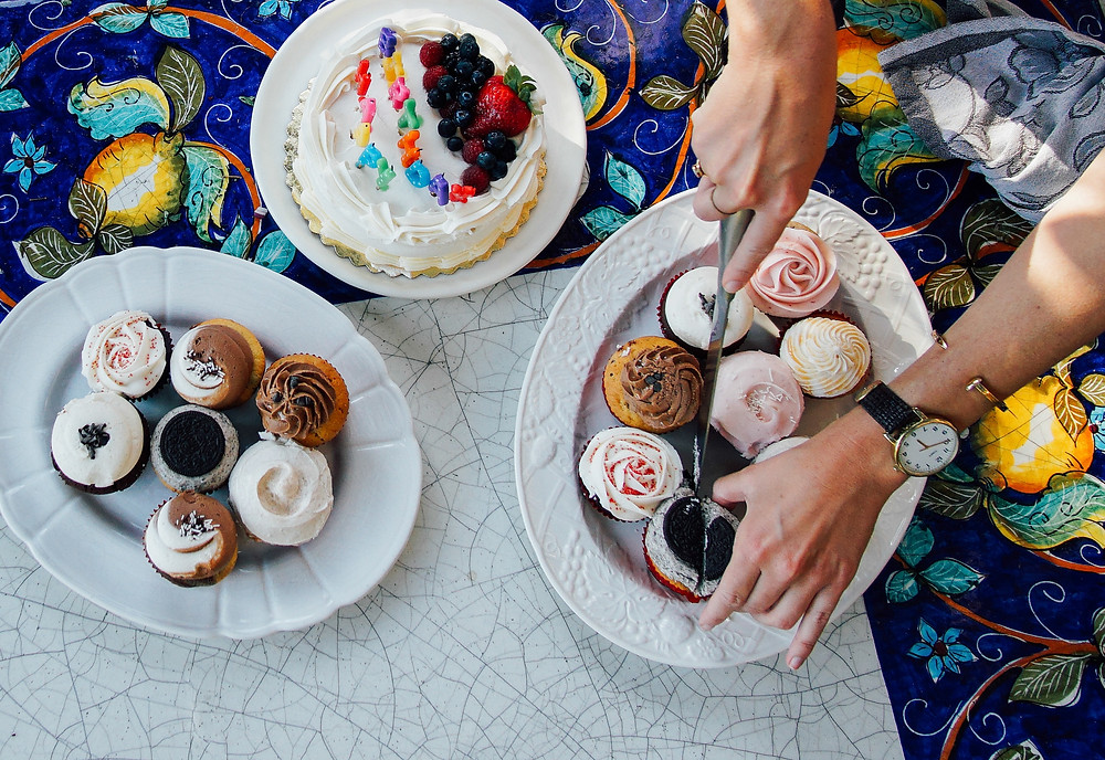 birthday cake and cupcakes on a table