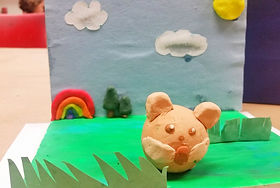A clay animal and sculpted background for a claymation project