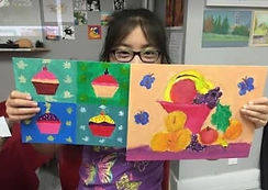 girl-holding-two-paintings.JPG