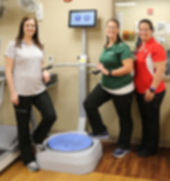 Physical Therapists with Balance Machine