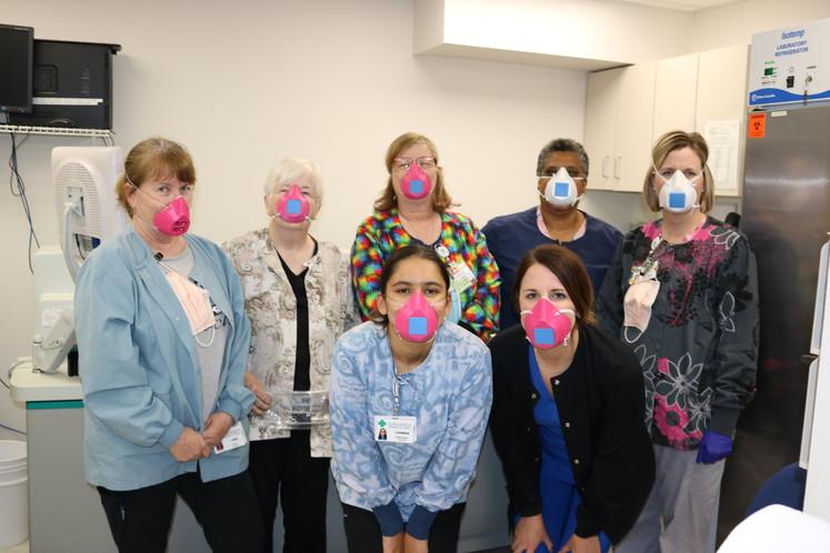 Lab staff wearing their 3D printed masks