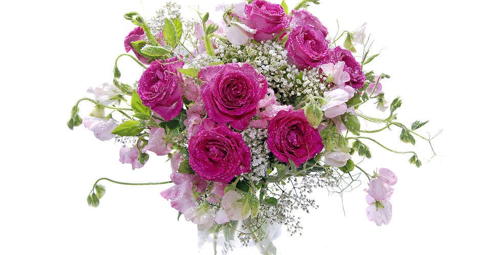 Whimsical roses and seasonal accent flowers