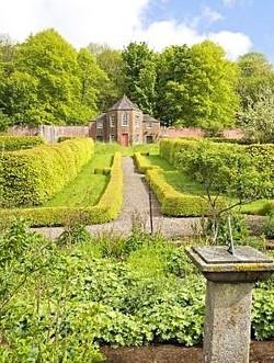 Summer house in walled garden