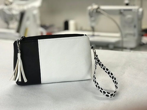 Black and white faux leather zipper cosmetic bag with tassle
